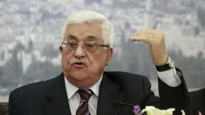 Palestinian President Mahmoud Abbas speaks during a meeting of the Palestinian leadership at his compound in the West Bank city of Ramallah, Wednesday, Dec 5, 2012. Israel's latest settlement plans will destroy any lingering hopes of setting up a Palestinian state next to Israel, a senior Palestinian official warned Tuesday, as international anger over such construction snowballed. (AP Photo/Nasser Shiyoukhi)