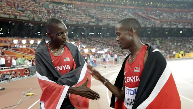 Kenya's Asbel Kiprop, left, celebrates winning the gold medal with Kenya's Elijah Motonei Manangoi, who took the silver, after the men's 1500m final at the World Athletics Championships at the Bird's Nest stadium in Beijing, Sunday, Aug. 30, 2015.  (AP Photo/Andy Wong)