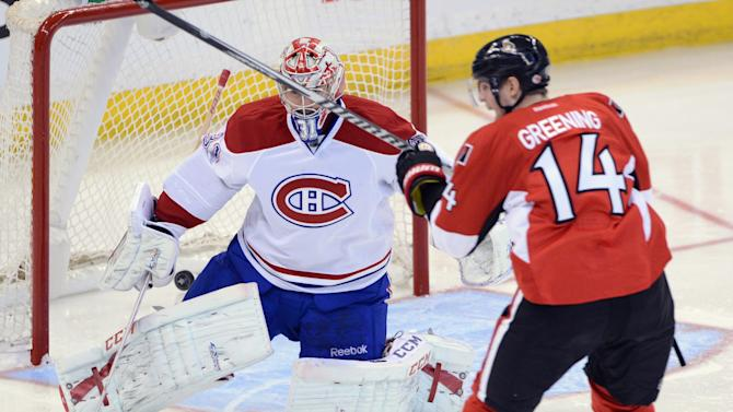 Ottawa Senators' Colin Greening watches as Jean-Gabriel Pageau's shot beats Montreal Canadiens goalie Carey Price during the third period of Game 3 of their first-round NHL hockey Stanley Cup playoff series, Sunday, May 5, 2013, in Ottawa, Ontario. (AP Photo/The Canadian Press, Sean Kilpatrick)