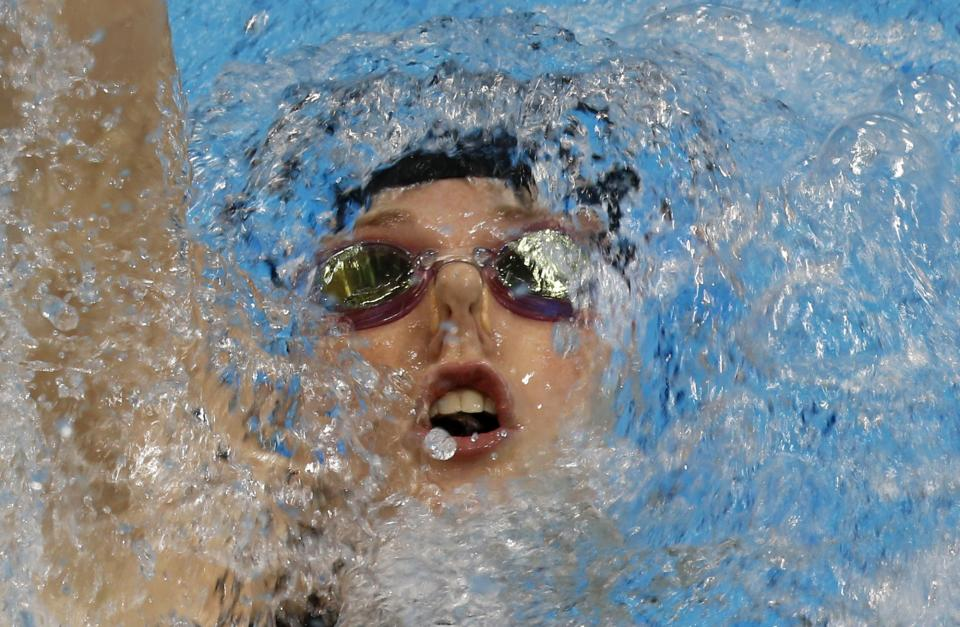 United States' Missy Franklin competes in the women's 200-meter backstroke final at the Aquatics Centre in the Olympic Park during the 2012 Summer Olympics in London, Friday, Aug. 3, 2012. Franklin won the gold.(AP Photo/Julio Cortez)