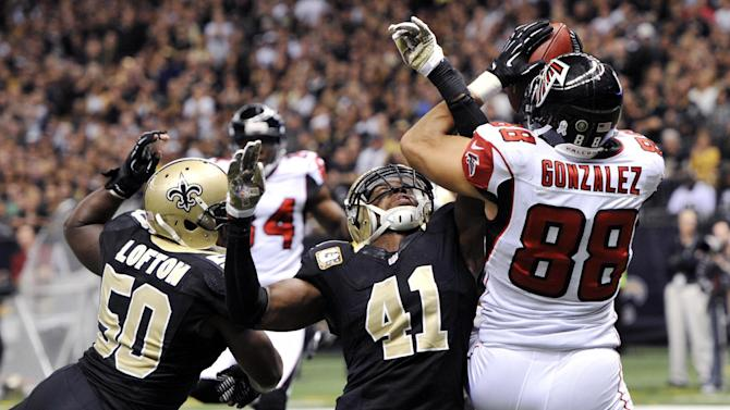 Atlanta Falcons tight end Tony Gonzalez (88) pulls in a touchdown reception over New Orleans Saints middle linebacker Curtis Lofton (50) and strong safety Roman Harper (41) in the second half of an NFL football game at Mercedes-Benz Superdome in New Orleans, Sunday, Nov. 11, 2012. The Saints won 31-27. (AP Photo/Bill Feig)