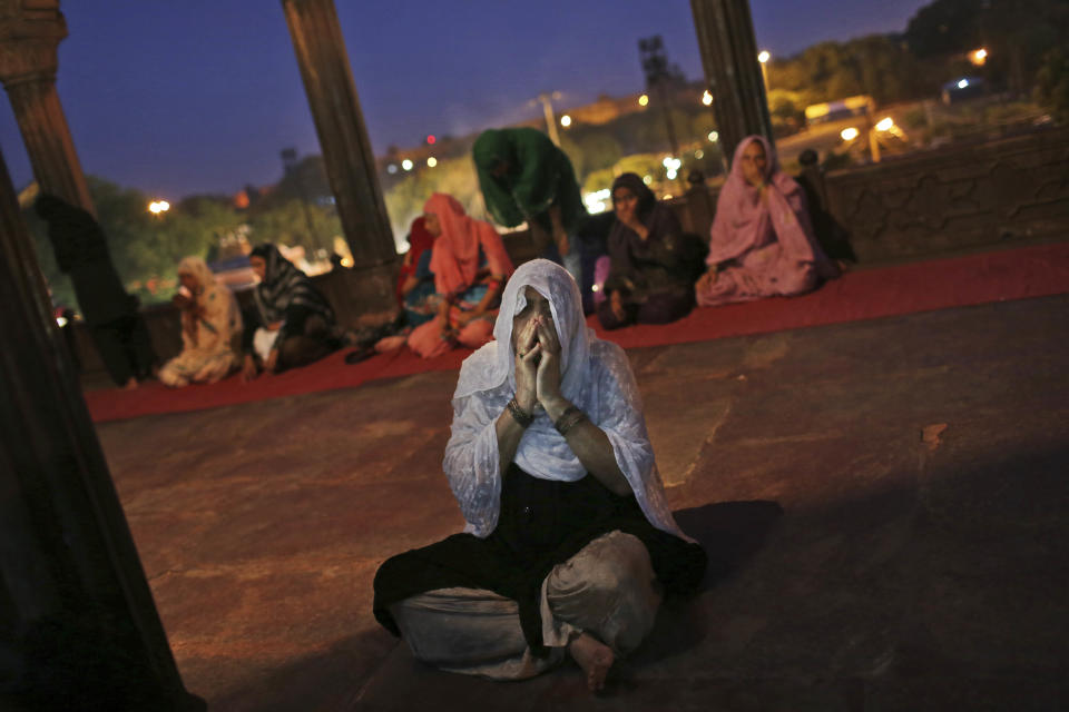 An Indian Muslim woman prays at the Jama Masjid  in New Delhi, India, Friday, July 20, 2012. Muslims in India are preparing to celebrate the holy fasting month of Ramadan, where observants fast from dawn until dusk.  (AP Photo/Kevin Frayer)