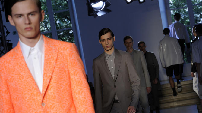 Models wear creations of the Jil Sander men's Spring-Summer 2014 collection, part of the Milan Fashion Week, unveiled in Milan, Italy, Saturday, June 22, 2013. (AP Photo/Giuseppe Aresu)