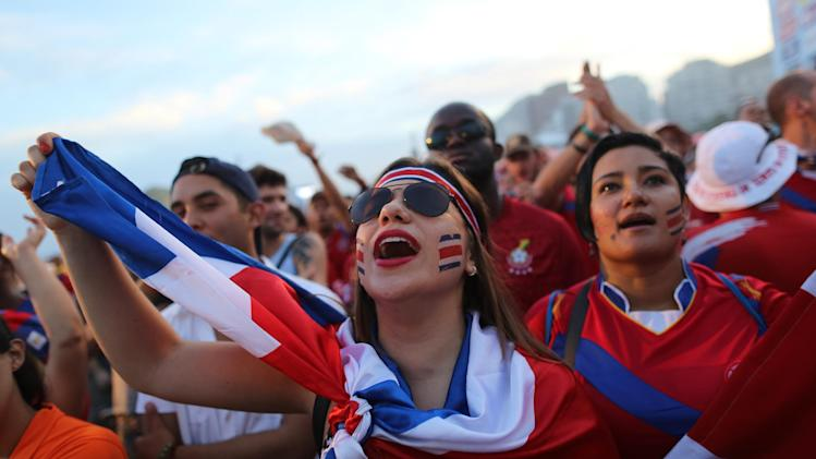 Costa Rica soccer fans watch their team's World Cup round of 16 match against Greece on a live telecast inside the FIFA Fan Fest area on Copacabana beach in Rio de Janeiro, Brazil, Sunday, June 29, 2014