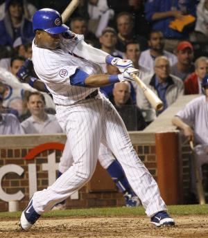 Chicago Cubs' Starlin Castro hits a two-run single off St. Louis Cardinals relief pitcher Jason Motte, scoring Aramis Ramirez and Carlos Pena, during the third inning of a baseball game Wednesday, May 11, 2011 in Chicago. Watching the play is catcher Gerald Laird. (AP Photo/Charles Rex Arbogast)