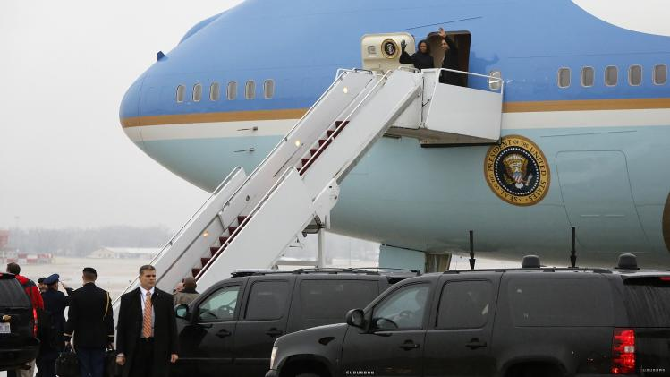 Obama and the first lady board Air Force One to depart for South Africa to attend memorial services for Mandela, from Joint Base Andrews, Maryland