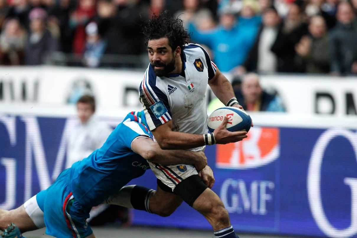 France s yoann huget right is tackled by italy s leonardo sarto