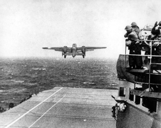 FILE - In this April 18, 1942 file photo, one of Lt. Col. Jimmy Doolittle's B-25 bombers takes off from the flight deck of the USS Hornet for the initial air raid on Tokyo. Coming just four months aft