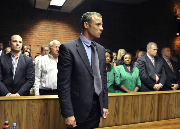 FILE - In this Feb. 19, 2013 file photo, olympian Oscar Pistorius stands following his bail hearing in Pretoria, South Africa. A judge in South Africa says Pistorius, who is charged with murdering his