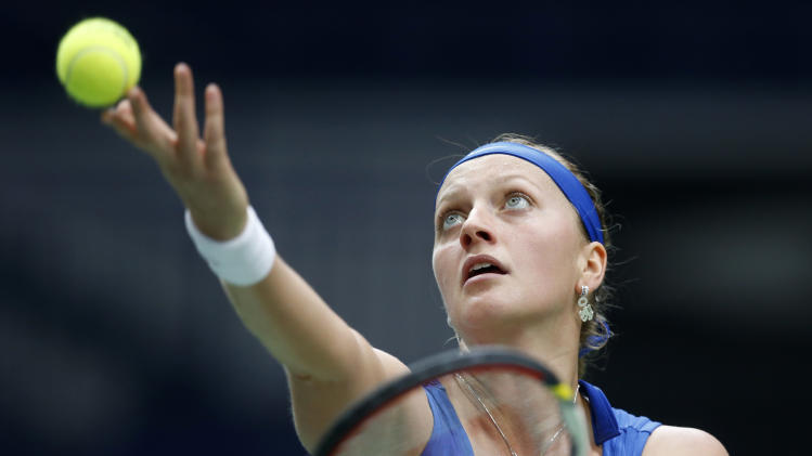 Czech Republic's Petra Kvitova serves a ball to Australia's Jarmila Gajdosova during their world group first round Fed Cup singles tennis match in Ostrava, Czech Republic, Saturday, Feb. 9, 2013. (AP Photo/Petr David Josek)