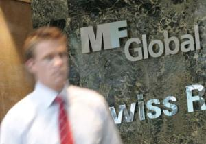 File photo of a man exiting the office complex where MF Global Holdings Ltd have an office on 52nd Street in midtown Manhattan New York