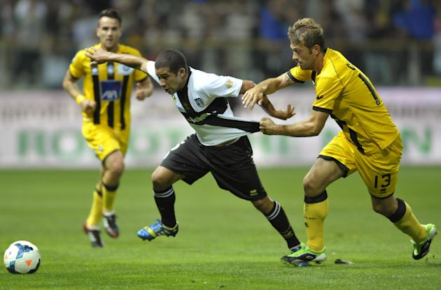 Parma's Walter Gargano of Uruguay, left, vies for the ball with Atalanta's Michele Canini, during their Serie A soccer match at Parma's Tardini stadium, Italy, Wednesday, Sept. 25, 2013