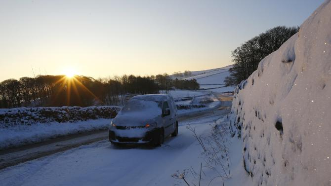 An abandoned car is seen on the A515 after snowfalls near Ashbourne