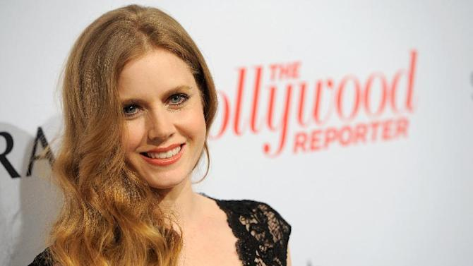IMAGE DISTRIBUTED FOR THE HOLLYWOOD REPORTER - Amy Adams arrives at The Hollywood Reporter Nominees' Night at Spago on Monday, Feb. 4, 2013, in Beverly Hills, Calif. (Photo by Chris Pizzello/Invision for The Hollywood Reporter/AP Images)
