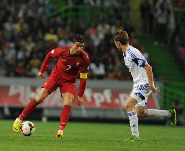 LISBON, Oct. 12, 2013 (Xinhua) -- Cristiano Ronaldo of Portugal competes during the FIFA 2014 World Cup Qualifying match between Portugal and Israel in Lisbon, Portugal on Oct. 11, 2013. The match end