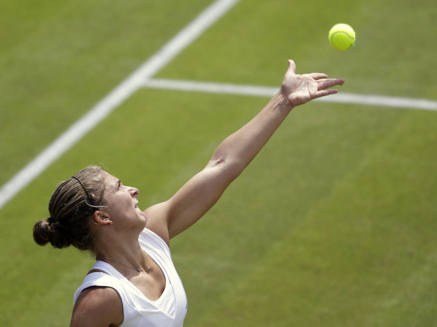Sara Errani of Italy serves to Anne Keothavong of Britain during a second round women's singles match at the All England Lawn Tennis Championships at Wimbledon, England, Thursday, June 28, 2012. (AP Photo/Alastair Grant)