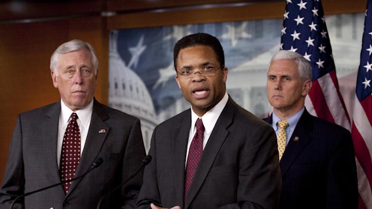 FILE - In this April 14, 2010 file photo, Rep. Jesse Jackson Jr., D-Ill., center, speaks on Capitol Hill in Washington. With the November election only five weeks away, Jackson's absence from work and the campaign trail is testing patience in Chicago. His GOP opponent is now criticizing him for it after pledging not to. Friendly editorial writers are now urging he come forward and finally explain himself. And Jackson's alderman wife, Sandi, is having to deny in public that she might step in to replace him. The Jackson camp says only that the congressman is still on the ballot and will only return to work when cleared for that by a doctor, but the uncertainty and mystery is feeding talk of what happens if he resigns and needs to be replaced, a process with a sordid history in Chicago and Illinois. He is flanked by then-House Majority Leader Steny Hoyer of Md., left, and Rep. Mike Pence, R-Ind. (AP Photo/Harry Hamburg, File)