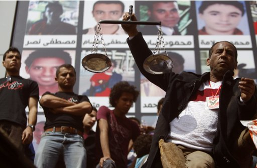 Al-Ahly fans react after hearing the final verdict of the 2012 Port Said massacre in Cairo