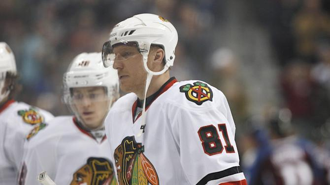 Chicago Blackhawks right wing Marian Hossa, of Slovakia, files off the ice with teammates after the Colorado Avalanche's 6-2 victory in an NHL hockey game in Denver on Friday, March 8, 2013. The Blackhawks lost in regulation for the first time this season. (AP Photo/David Zalubowski)