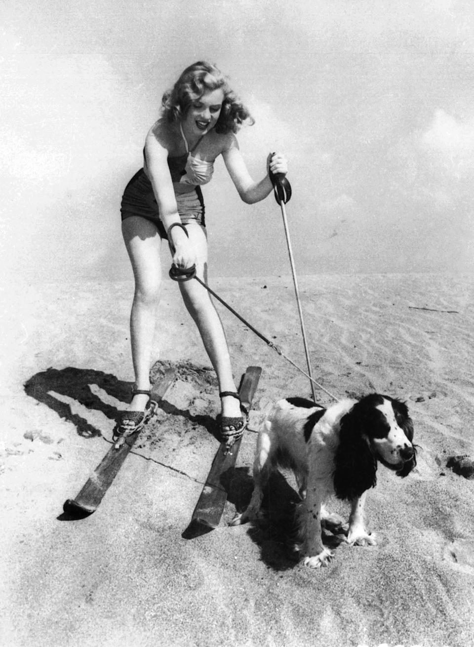 FILE - In this January 1, 1947 file photo, starlet Marilyn Monroe plays at the beach with her dog Ruffles. (AP Photo, File)