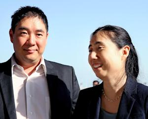American couple Grace, right, and Matthew Huang arrive …