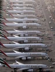 Emirates planes sits on the tarmac at the Dubai International Airport. The deal goes beyond codesharing to include coordinated pricing, sales and scheduling and a benefit-sharing model, although neither airline will take equity in the other