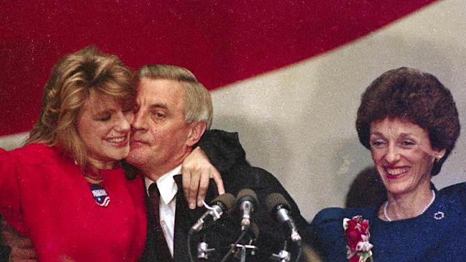 FILE - In this Nov. 7, 1984 file photo, Walter Mondale is hugged by his daughter Eleanor as his wife Joan looks on at the St. Paul Civic Center in St. Paul, Minn., where Mondale conceded the presidential race to Ronald Reagan. Eleanor Mondale, a vice president's daughter who carved out her own identity as a broadcast journalist and gossip magnet, died at her home in Minnesota, Saturday, Sept. 17, 2011, according to a family spokesperson. Mondale was 51. (AP Photo/Jim Mone, File)