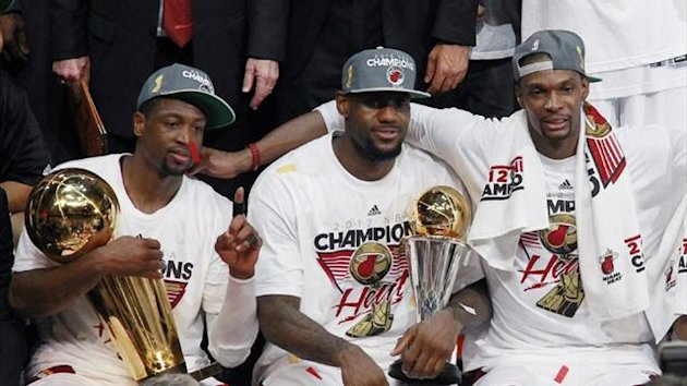 2011-12 NBA Miami Heat's Wade, James and Bosh celebrate with the trophy after winning the championship in Game 5 of the NBA Finals
