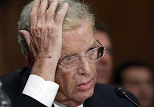 Cayne, former Chairman and CEO of Bear Stearns, puts his hand to his head as he testifies at a hearing held by the Financial Crisis Inquiry Commission in Washington