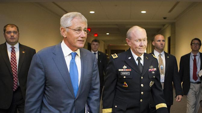 Defense Secretary Chuck Hagel, left, and Joint Chiefs Chairman Gen. Martin Dempsey, right, arrive for a closed-door intelligence briefing with members of the House of Representatives on the situation in Syria, at the Capitol, in Washington, Monday, Sept. 9, 2013. It is the first full day of legislative business for Congress as lawmakers return from the August recess and President Barack Obama is seeking congressional approval for a military strike against Syria for its use of chemical weapons in the civil war. (AP Photo/J. Scott Applewhite)