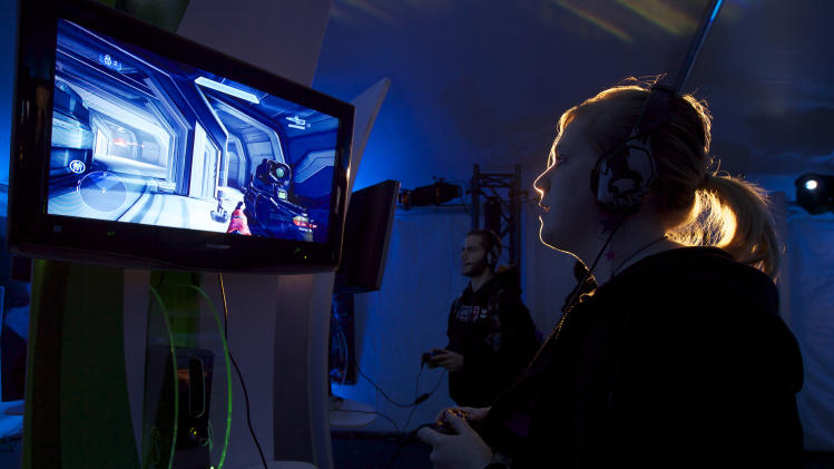 IMAGE DISTRIBUTED FOR XBOX - Lizzie Caldwell of Seattle plays Halo 4 before the game's launch, on Monday, Nov. 5, 2012 in Seattle. (Photo by Stephen Brasher/Invision for Xbox/AP Images)