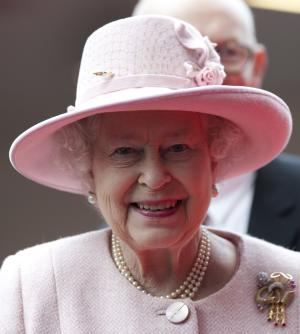 Britain's Queen Elizabeth II smiles during her visit to the Manchester Central convention centre, Manchester, England, Friday, March 23, 2012. (AP Photo/Jon Super, Pool)