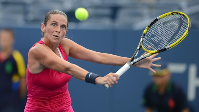 Italy's Roberta Vinci returns a shot to Italy's Sara Errani in the quarterfinals of the 2012 US Open tennis tournament, Wednesday, Sept. 5, 2012, in New York. (AP Photo/Henny Ray Abrams)