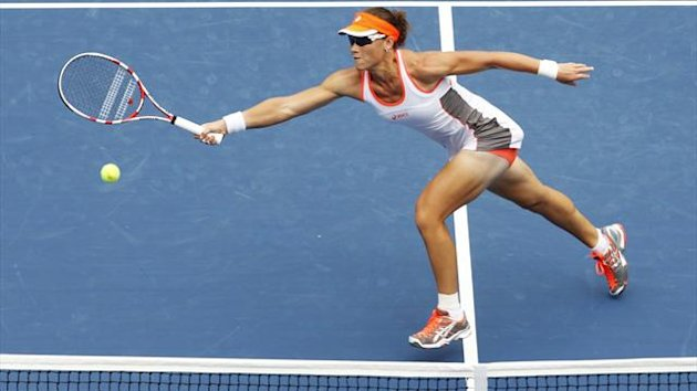 Samantha Stosur of Australia hits a return to Petra Martic of Croatia during their women's singles match at the U.S. Open tennis tournament in New York August 27, 2012 (Reuters)