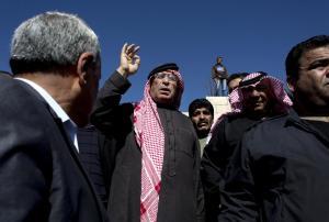 Safi al-Kaseasbeh, center, father of slain Jordanian…