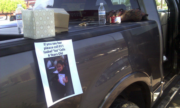 A flyer for missing 6-year-old Isabel Celis is placed on a volunteer&#39;s car in Tucson, Ariz., Sunday, April 22, 2012. Police cordoned off a neighborhood block where the girl went missing from her home during the night, as authorities fanned out Sunday over a wide area looking for clues to the possible kidnapping. (AP Photo/Terry Tang)