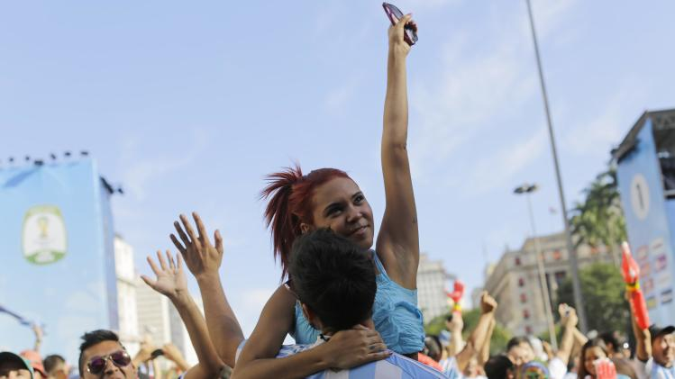 Argentina soccer fans celebrate their team's World Cup victory over Belgium, inside the FIFA Fan Fest area in Sao Paulo, Brazil, Saturday, July 5, 2014. Gonzalo Higuain's first goal of this World Cup sent Argentina into the semifinals on Saturday with a 1-0 win over Belgium