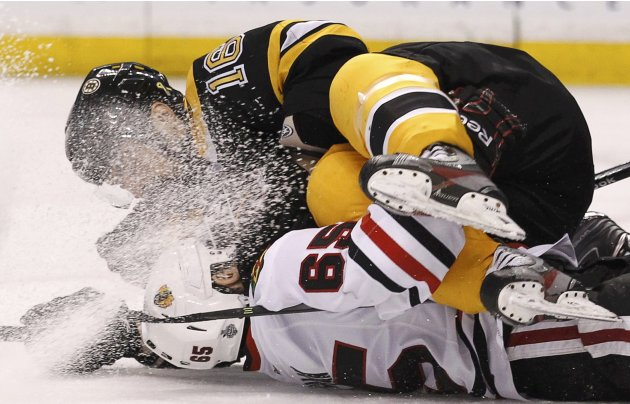 Bruins' Daugavins fall on top of Chicago Blackhawks' Shaw during the third period in Game 4 of their NHL Stanley Cup Finals hockey series in Boston