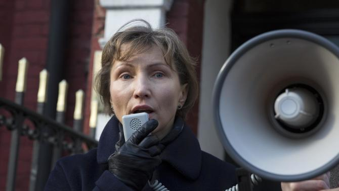 Marina Litvinenko, the widow of murdered KGB agent Alexander Litvinenko, speaks during a demonstration in support of Boris Nemtsov, former deputy prime minister of Russia and prominent critic of Vladimir Putin, outside the Russian Embassy in London