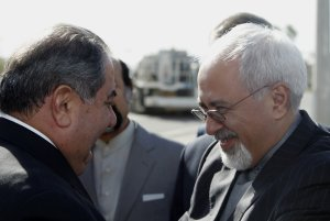 Iran's Foreign Minister Mohammed Javad Zarif, right,…