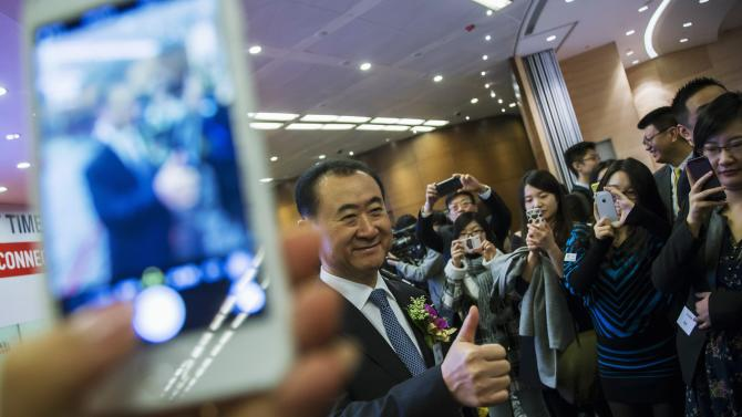 Wang Jianlin, chairman of Wanda commercial properties, flashes a thumbs up during the debut of the company at the Hong Kong Stock Exchange