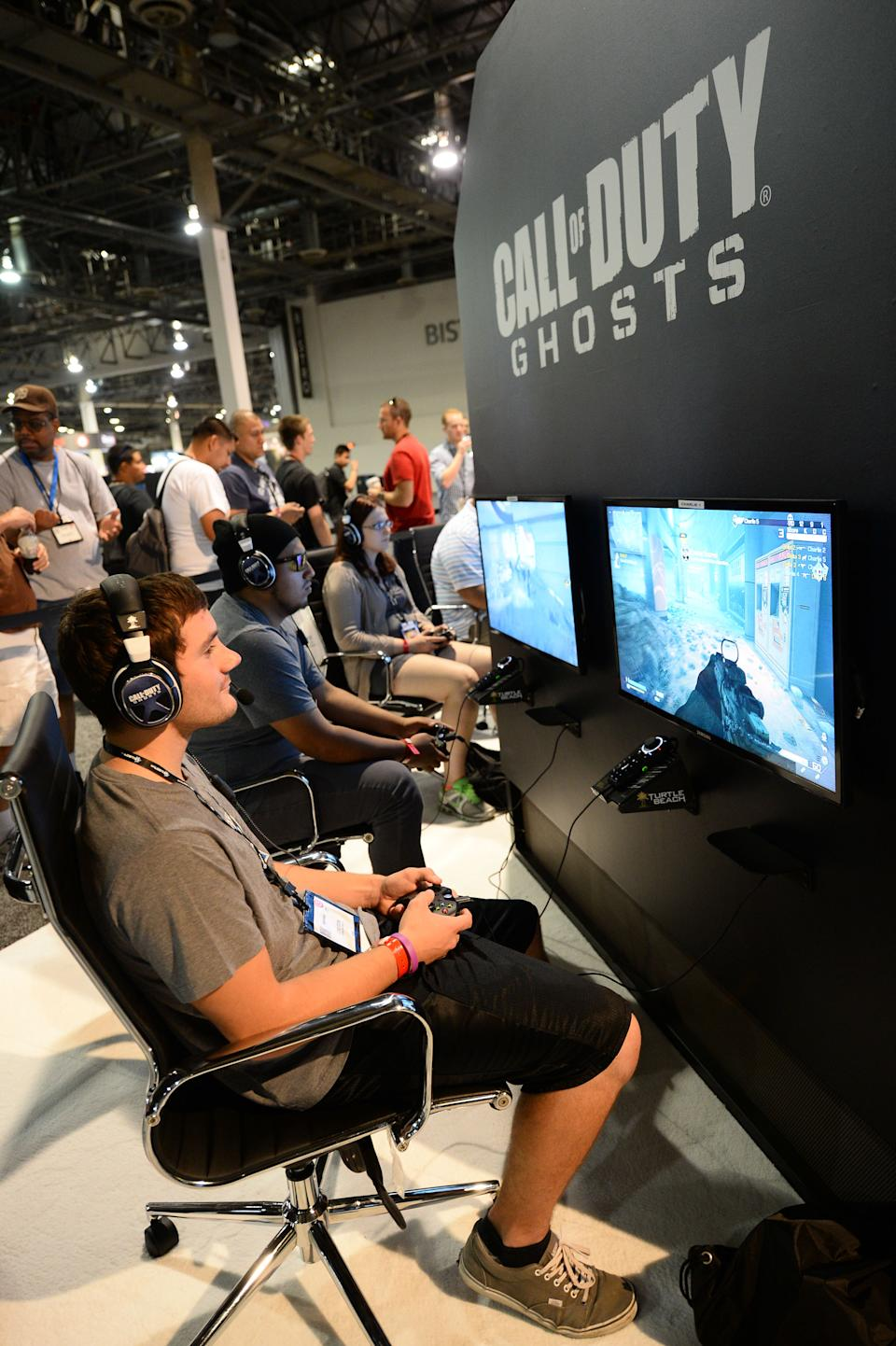 "Attendees play ""Call of Duty: Ghosts"" at the GameStop Expo in Las Vegas on Wednesday, Aug. 28, 2013. (Photo by Al Powers/Invision/AP)"