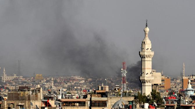 In this citizen journalist image, smoke billows over Damascus, Syria, Wednesday, July 18, 2012. A bomb ripped through a high-level security meeting Wednesday in Damascus, killing three top regime officials — including President Bashar Assad's brother-in-law — in the harshest blow to Syria's ruling family dynasty and the rebels' boldest attack in the country's civil war. Syrian state-run TV said the blast came during a meeting of Cabinet ministers and senior security officials in Damascus, which has seen four straight days of clashes between rebels and government troops. (AP Photo)