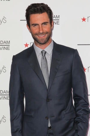 """FILE - In this Feb. 7, 2013 file photo, recording artist Adam Levine attends the launch of """"Adam Levine Signature Fragrances"""" at Macy's Westfield Century City, in Century City, Calif. Levine is named Sexiest Man Alive 2013 by People magazine announced Tuesday, Nov. 19, 2013. He is a coach on the NBC's hit series, """"The Voice."""" (Photo by Paul A. Hebert/Invision/AP, File)"""