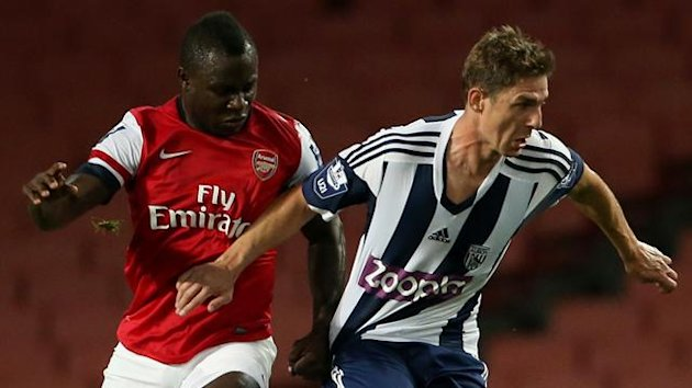 Arsenal's Emmanuel Frimpong (left) and West Bromwich Albion's Zoltan Gera (right) battle for possession of the ball. (PA Photos)