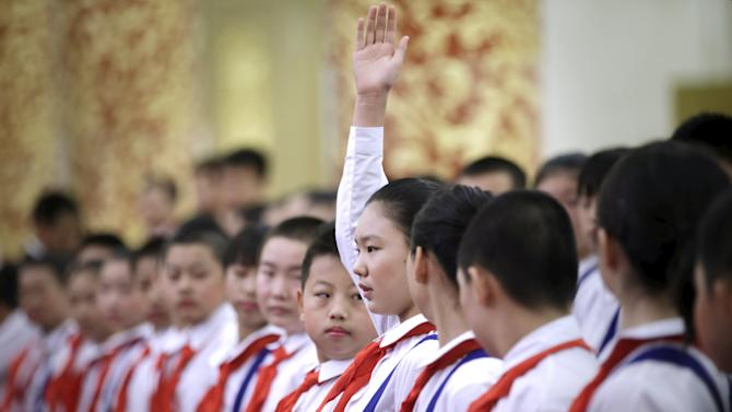 Students prepare ahead of a medal ceremony marking the 70th anniversary of the Victory of Chinese People's War of Resistance Against Japanese Aggression in Beijing