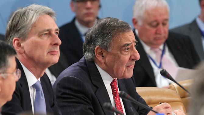 U.S. Secretary of Defense Leon Panetta, right, and Britain's Secretary of State for Defense Philip Hammond attend the two-day NATO defense ministers meeting to discuss Syria and Afghanistan, at NATO headquarters in Brussels, Thursday, Feb. 21, 2013. The head of NATO urged member countries Thursday to stop cutting their defense budgets in response to tough economic times, saying continued reductions will compromise the safety of all of the military alliance's 28 members. (AP Photo/Yves Logghe)