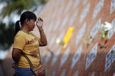 Somjai Somboon, 40, whose 13-year-old son was killed in the 2004 tsunami, cries at the memorial for tsunami victims in Ban Nam Khem