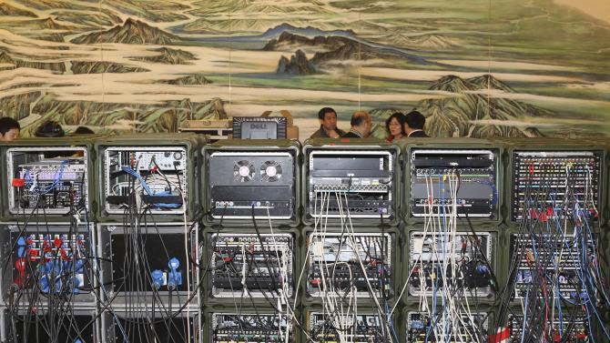 In this Saturday, March 9, 2013 photo, TV broadcast equipments are set up for news conferences inside the Great Hall of the People, where the National People's Congress is held, in Beijing. (AP Photo/Kin Cheung)