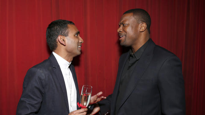 Delta Director Ranjan Goswami and Chris Tucker attend at a Celebration of LA's Music Industry at the Getty House on Thursday, Feb. 7, 2013 in Los Angeles. (Photo by Todd Williamson/Invision/AP)